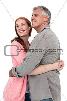 Casual couple hugging and smiling
