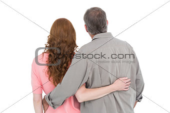 Casual couple standing arm around