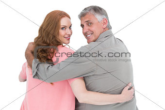 Casual couple standing arms around