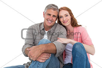 Casual couple sitting and smiling