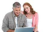Casual couple looking at laptop