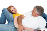 Casual couple lying on floor