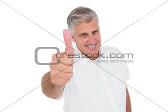 Casual man showing thumbs up at camera