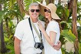 Holidaying couple smiling at camera