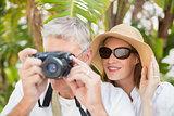 Holidaying couple taking a photo