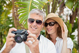 Holidaying couple taking a photo