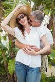 Holidaying couple hugging and smiling