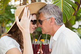 Holidaying couple toasting with cocktails
