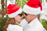 Holidaying couple celebrating christmas