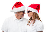 Festive couple smiling at each other