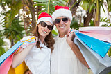 Festive couple holding shopping bags