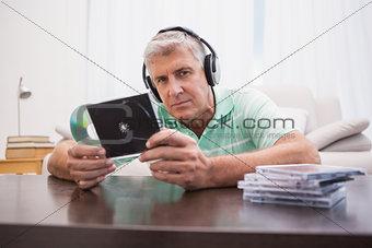 Mature man listening to cds