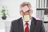 Confused businessman with sticky notes on head