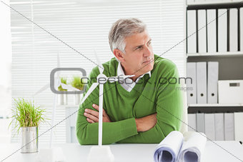Casual businessman looking at away