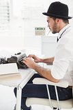 Hipster businessman using a typewriter
