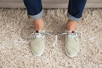 Casual mans shoelaces tied together