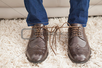 Classy mans shoelaces tied together