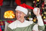 Smiling man wearing santa hat