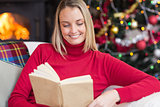 Pretty blonde reading book at christmas time