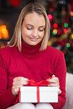 Festive blonde opening christmas gift