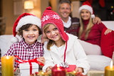 Cute family celebrating christmas together