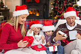 Festive shocked family exchanging gifts