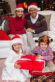 Family in santa hats celebrating christmas