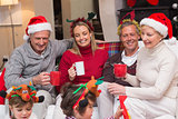 Happy extended family enjoying coffee at christmas time