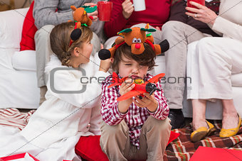 Little boy playing with toy airplane during christmas time
