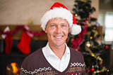 Portrait of a smiling handsome man in santa hat