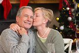 Mature woman kissing the cheek of her husband