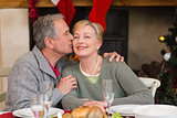 Mature man kissing the cheek of his wife