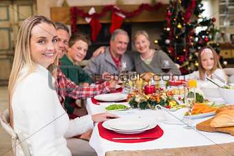 Three generation family having christmas dinner together