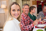 Woman smiling at camera during christmas dinner