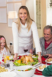 Woman serving roast turkey at christmas