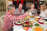 Three generation family having christmas dinner together