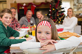Portrait of smiling daughter during christmas dinner