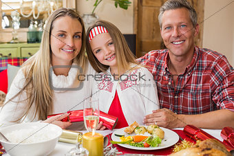 Portrait of parents and daughter together at christmas time