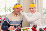 Smiling mature couple in party hat
