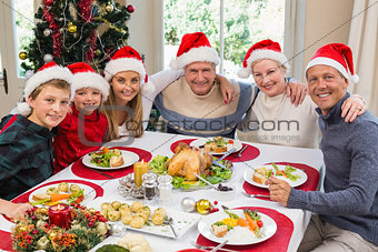 Portrait of smiling family sitting together at christmas dinner