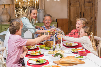 Three generation family enjoying christmas dinner together