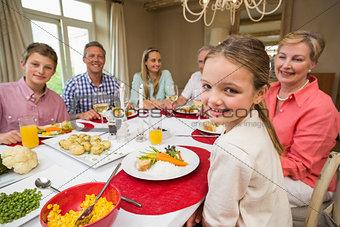 Portrait of pretty little girl during christmas dinner