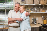 Senior couple hugging and smiling