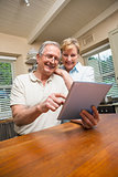Senior couple looking at tablet pc together