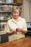 Senior woman sending a text message