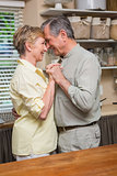 Romantic senior couple dancing together