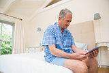 Senior man using tablet pc