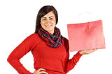 Smiling brunette showing red gift bag