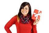 Happy brunette showing a gift