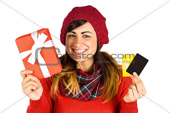 Smiling brunette holding gift and cards
